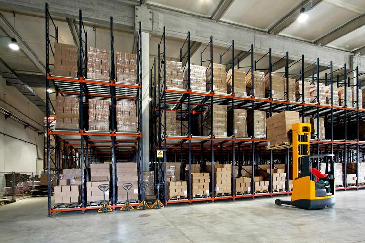 Man on forklift in warehouse