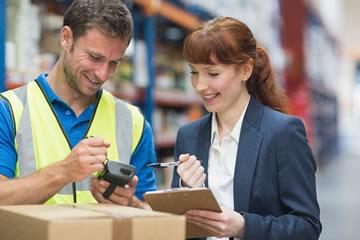Warehouse staff accessing cloud logistics software
