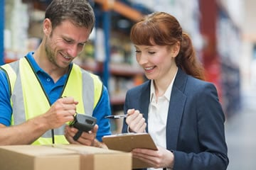 Warehouse staff accessing cloud logistics software