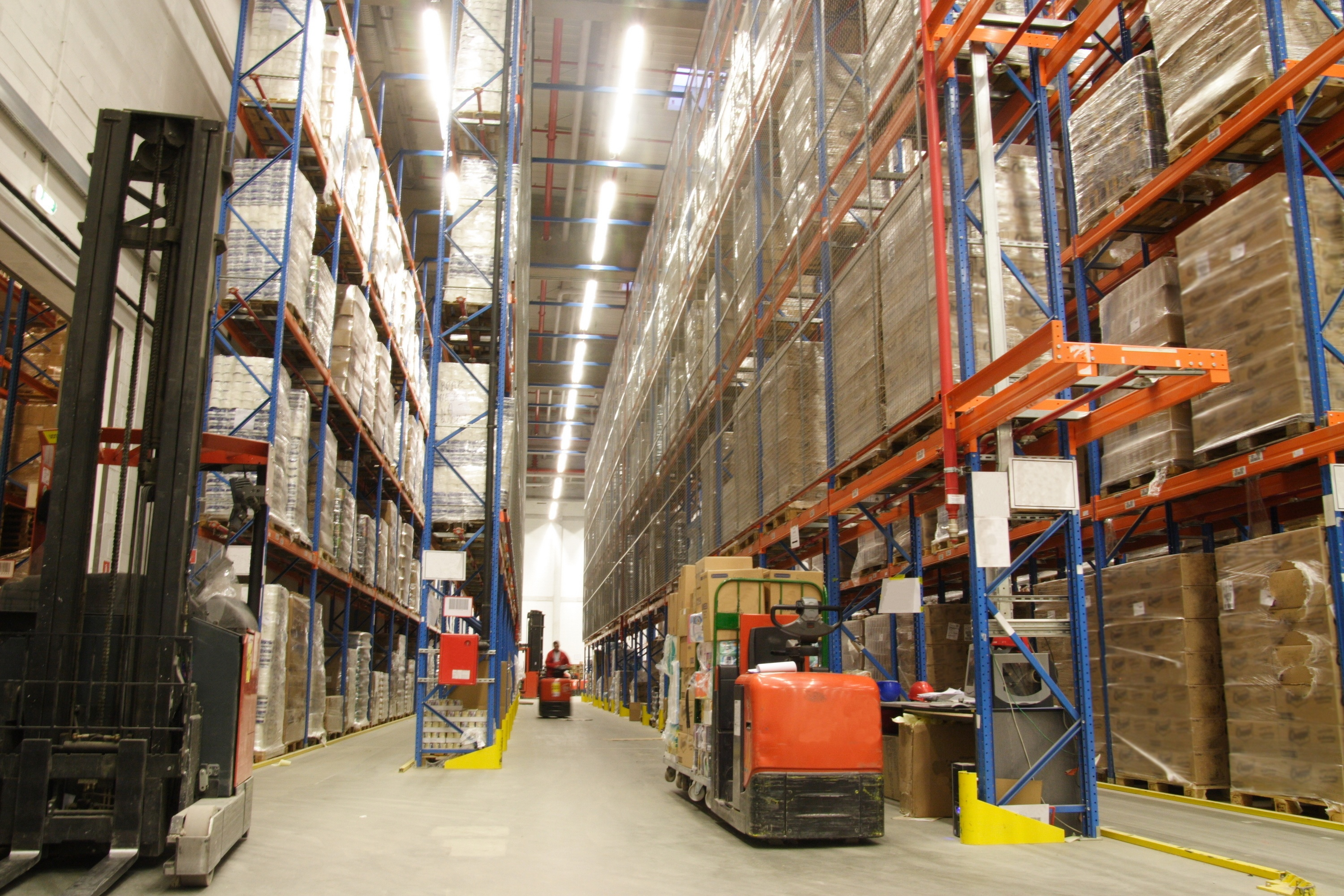 Tall_Warehouse_shelves_with_forklift_-_BigStock_image_-_Large_-_13.03.2013.jpg